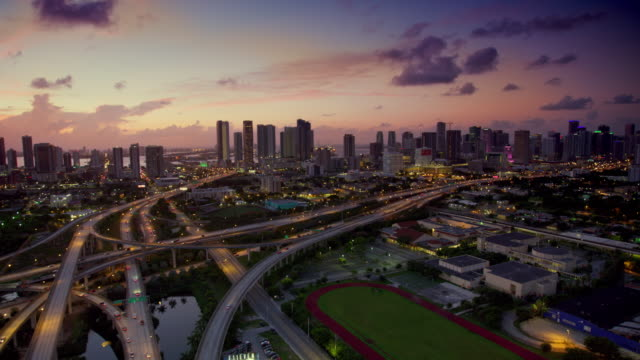 aerial miami highway interchange at dawn - elevated road stock videos & royalty-free footage
