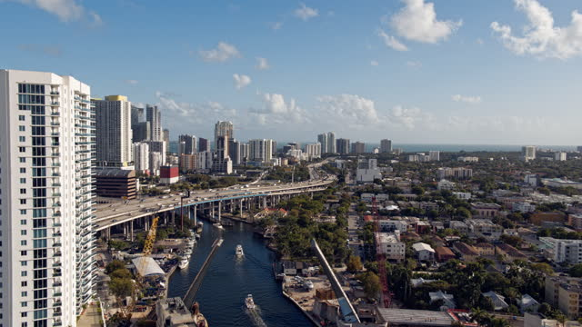 miami river dividing downtown miami and wealth oceanside-districts komodo and brickell with the residential east little havana neighborhood. aerial footage with the forward camera motion. - bascule bridge stock videos & royalty-free footage