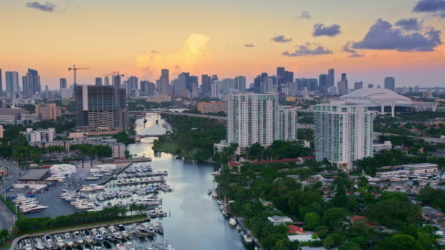aerial miami river near marlins park at sunset - florida usa stock videos & royalty-free footage