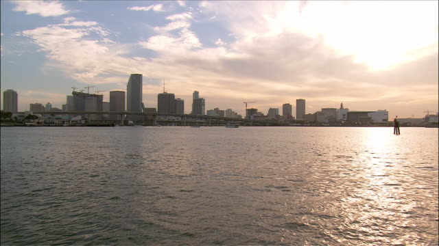 miami skyline across biscayne bay / miami, florida - biscayne bay stock-videos und b-roll-filmmaterial