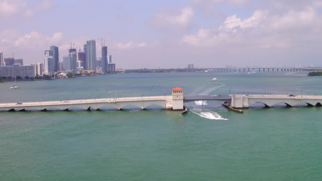 miami, united states: aerial view of the city skyline and biscayne bay in day time. the tropical climate and beach makes the city a major travel destination in the country - biscayne bay stock videos and b-roll footage