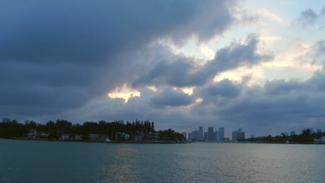 miami, united states: city urban skyline at dusk, point of view from a tourist cruise in the biscayne bay - biscayne bay stock videos & royalty-free footage