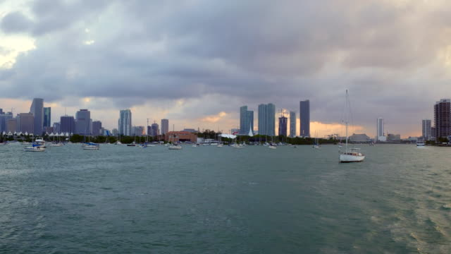Miami, United States: city urban skyline at dusk, point of view from a tourist cruise in the Biscayne bay
