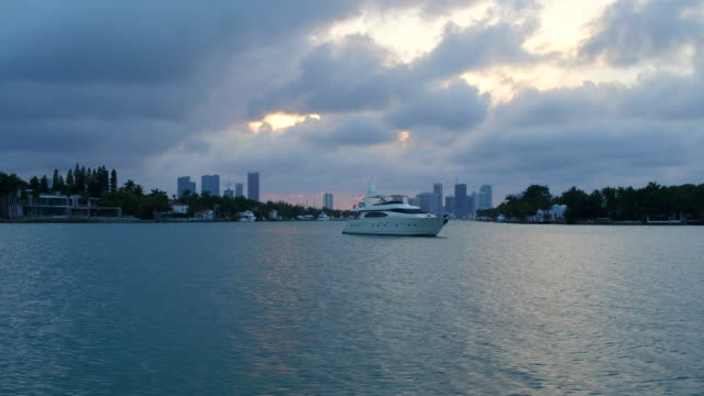 stockvideo's en b-roll-footage met miami, united states: city urban skyline at dusk, point of view from a tourist cruise in the biscayne bay - biscayne bay