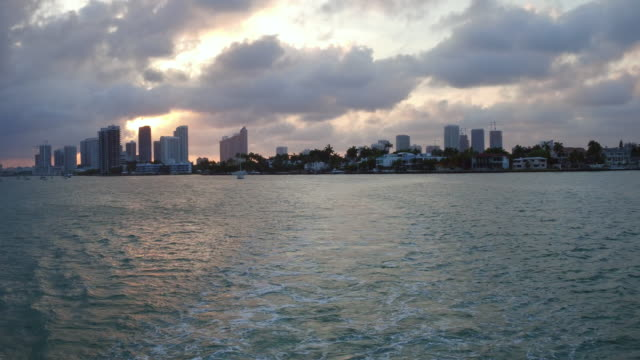 miami, united states: city urban skyline at dusk, point of view from a tourist cruise in the biscayne bay - biscayne bay stock videos and b-roll footage