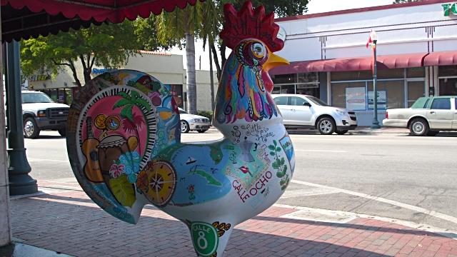Miami, United States: rooster sculpture traditional symbol of the Cuban community in Little Havana. Everyday lifestyle in the famous street during daytime