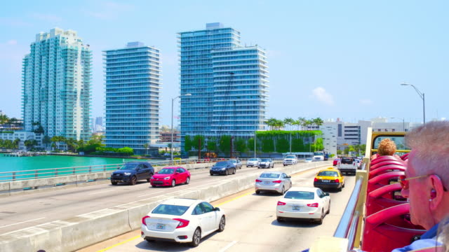 Miami, United States: Sightseeing the modern buildings and the Biscayne Bay, point of view from a tourist bus