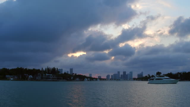 miami, united states: urban skyline point of view from tourist boat tour in the biscayne bay. the trips is a tourist attraction departing from bayside commercial center in the florida state city - biscayne bay stock videos and b-roll footage
