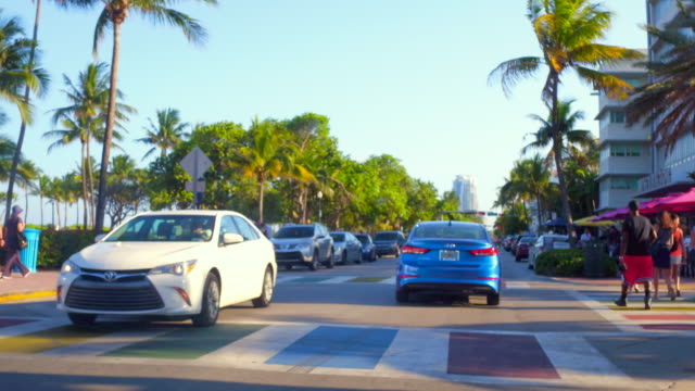 miami, usa: ocean drive, point of view from inside a taxi - south beach stock videos & royalty-free footage