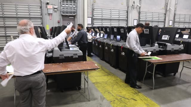 miamidade election support specialists check voting machines for accuracy at the miamidade election department headquarters on august 8 2018 in doral... - doral stock videos and b-roll footage