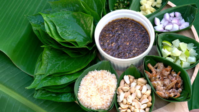miang kam, a delicious snack thai food. - peanut food stock videos and b-roll footage