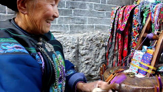 Miao ethnic old lady traditional weaving,medium shot