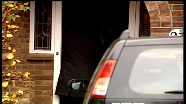 michael and debbie fawcett outside of house england london ext debbie fawcett locking car in drive in through front door / michael fawcett speaking... - michael fawcett stock videos and b-roll footage