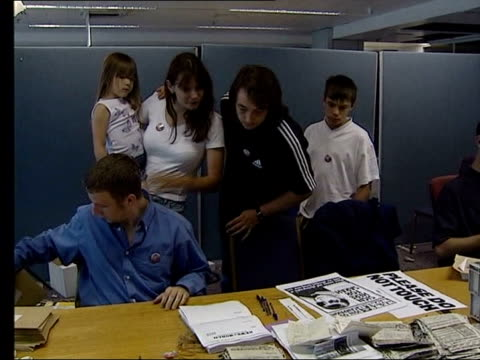 lib michael and sara payne visiting room where newspaper coupons were being put together to form a petition calling for 'sarah's law' - petition stock videos & royalty-free footage