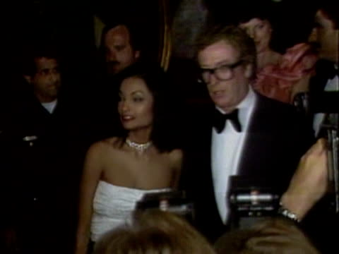 michael and shakira caine arrive at a hollywood gala to raise funds for the british olympic team. april 1984. - 俳優 マイケル・ケイン点の映像素材/bロール