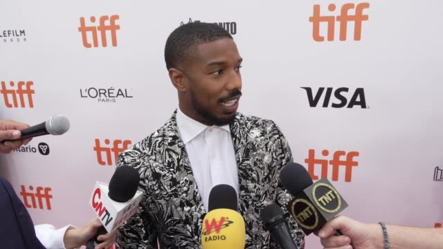 vídeos de stock, filmes e b-roll de interview michael b jordan on why this was a passion project for him the importance of telling this story and how it was to not only star in the film... - festival de cinema de toronto