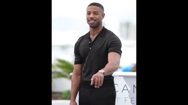 Michael B Jordan points to photographers at the 'Farenheit 451' photocall during the 71st Cannes Film Festival on May 12 2018 in Cannes France
