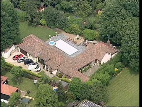 michael barrymore - autobiography postponed/ perjury investigation; lib roydon: air views michael barrymore's house and swimming pool - biographie stock-videos und b-roll-filmmaterial