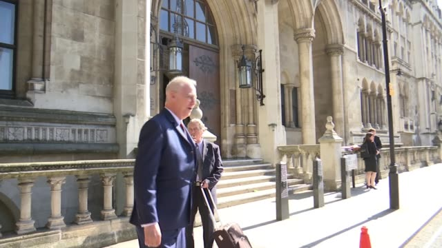 michael barrymore begins high court damages case against essex police; england: london: high court: ext michael barrymore along with legal team... - michael barrymore stock videos & royalty-free footage