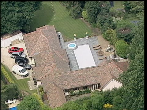michael barrymore gives evidence at stuart lubbock death inquest; lib air view barrymore's house lms front door of barrymore's house seen thru metal... - michael barrymore stock-videos und b-roll-filmmaterial