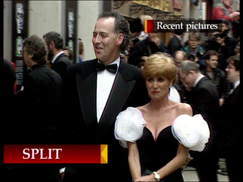 michael barrymore splits from wife; itn england: london: ext lms michael barrymore & wife cheryl towards outside bafta award ceremony bv michael &... - michael barrymore stock videos & royalty-free footage