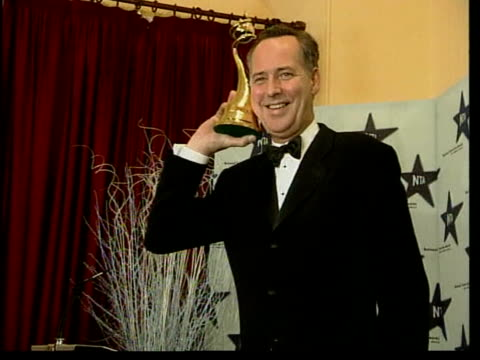 Michael Barrymore TV interview LIB Royal Albert Hall Barrymore posing with award after National TV Awards ceremony