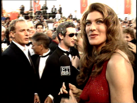 Michael Bolton Alan Menken to reporters on the red carpet at the 70th Annual Academy Awards