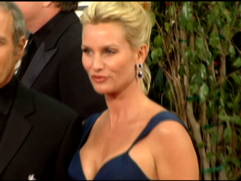 Michael Bolton and Nicollette Sheridan at the 2006 Golden Globe Awards Arrivals at the Beverly Hilton in Beverly Hills California on January 16 2006