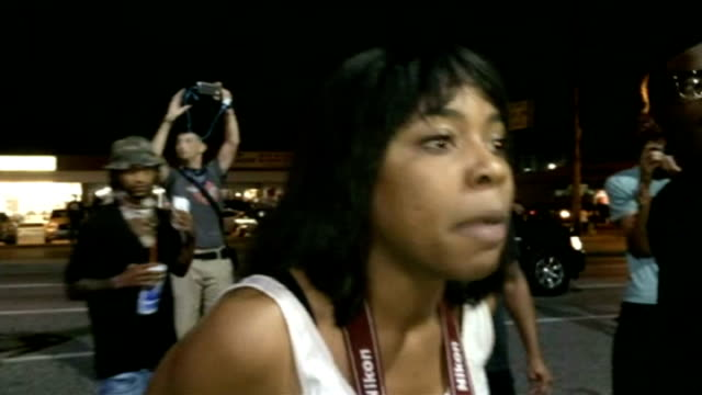 National Guard deployed in Ferguson Woman screaming at riot police SOT There our freedom this ain't free we're not free we're not free at all