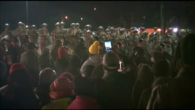 Protests continue following decision not to charge police officer Missouri Ferguson Crowd of protesters Protesters chanting 'fight back' SOT