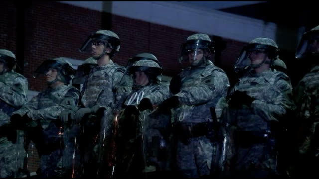 protests continue following decision not to charge police officer missouri ferguson national guard officers and riot police officers inside grounds... - national guard stock videos and b-roll footage