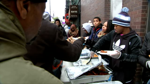 michael brown shooting / thanksgiving holiday protests continue new york ext people queuing at thanksgiving food bank for the needy food piled on... - thanksgiving plate stock videos & royalty-free footage
