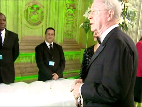michael caine and his wife shakira arrive for an nspcc party - shakira caine stock videos and b-roll footage