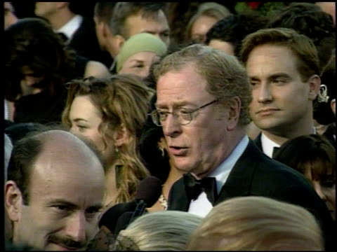 Michael Caine at the 1998 Academy Awards Arrivals at the Shrine Auditorium in Los Angeles California on March 23 1998