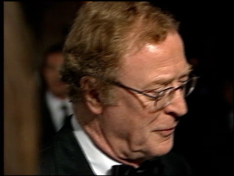 michael caine at the 1998 academy awards vanity fair party at morton's in west hollywood, california on march 23, 1998. - 第70回アカデミー賞点の映像素材/bロール
