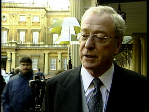 michael caine knighted; itn ext sir maurice micklewhite interview sot - talks of why he was knighted using his real name - because it was his... - 俳優 マイケル・ケイン点の映像素材/bロール