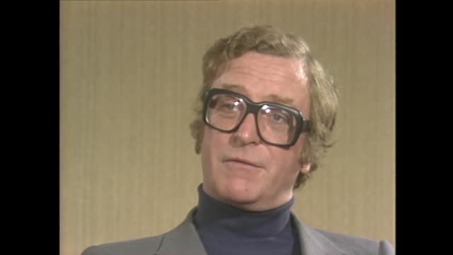 michael caine on attending his first hollywood party - beverly hills stock-videos und b-roll-filmmaterial
