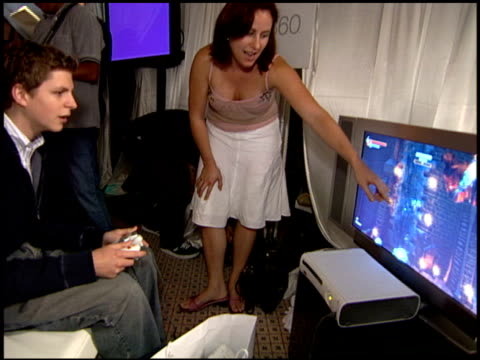 michael cera plays xbox at the xbox 360 at the extra emmy lounge at the le merridien hotel in beverly hills california on september 15 2005 - xbox stock videos & royalty-free footage
