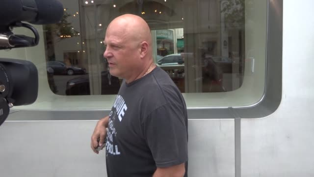 michael chiklis talks about if he buys cheap shoes or expensive shoes while shopping in beverly hills in celebrity sightings in los angeles, - michael chiklis stock videos & royalty-free footage