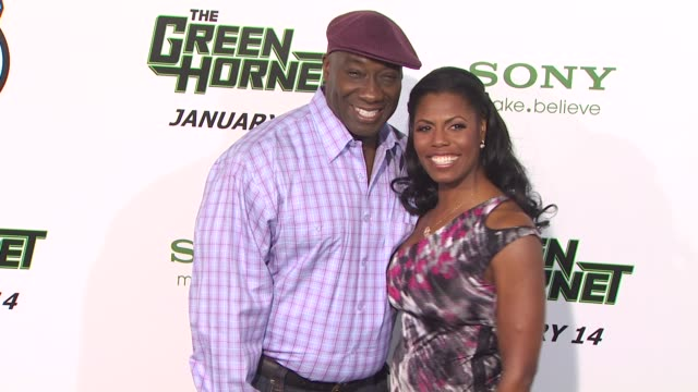 michael clarke duncan and omarosa manigaultstallworth at the 'the green hornet' premiere at hollywood ca - omarosa manigault newman stock videos & royalty-free footage