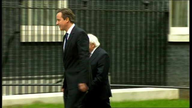 michael d. higgins meets david cameron at downing street; england: london: downing street: ext michael d. higgins chatting to david cameron mp and... - mp stock-videos und b-roll-filmmaterial