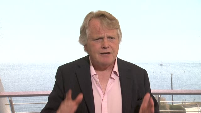 stockvideo's en b-roll-footage met interview michael dobbs on writing 'fu' how that phrase initials have been with him since at the 54th montecarlo television festival day 5 on june 11... - michael dobbs