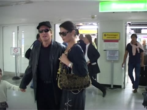 michael douglas and catherine zeta jones with children dylan and carys arrive at heathrow for family visit. michael holds dylan's hand as they... - michael douglas stock videos & royalty-free footage