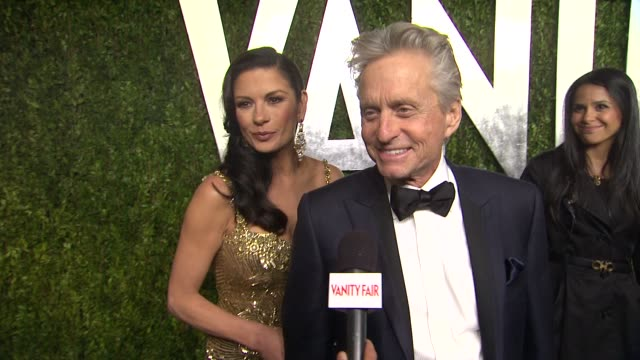 vídeos de stock, filmes e b-roll de interview michael douglas and catherine zetajones at the 2013 vanity fair oscar party hosted by graydon carter interview michael douglas and... - vanity fair oscar party