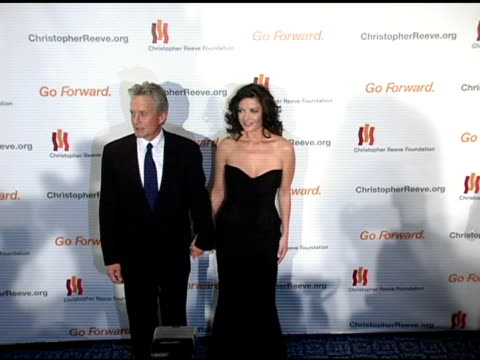 michael douglas and catherine zeta-jones at the 'a magical evening' sponsored by the christopher reeve foundation at the mariott marquis in new york,... - キャサリン・ゼタ・ジョーンズ点の映像素材/bロール