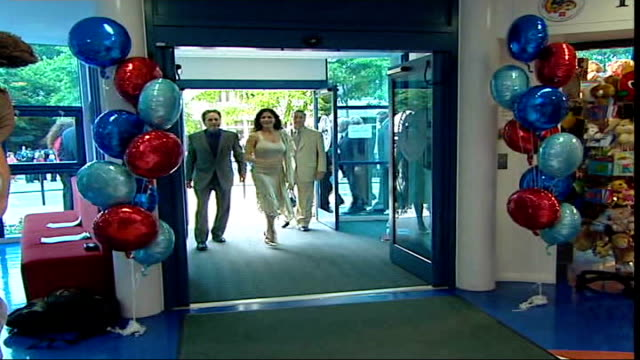 michael douglas in new film 'the sentinel'; fade to... file / r20060612 wales: cardiff: int michael douglas and catherine zeta jones arriving for... - michael douglas stock videos & royalty-free footage