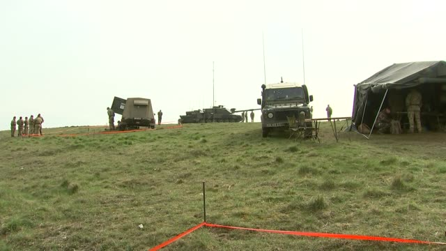 michael fallon and jean-yves le drian attend training exercise; england: wiltshire: salisbury plain: ext general views soldiers, helicopters and... - army stock videos & royalty-free footage