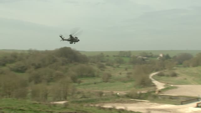michael fallon and jeanyves le drian attend training exercise tanks along / helicopters / military training exercise - military exercise stock videos and b-roll footage