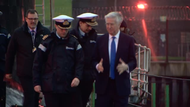 Michael Fallon visits Faslane naval base SCOTLAND Faslane naval base EXT Cars arriving / Michael Fallon MP out of car and along with officers /...