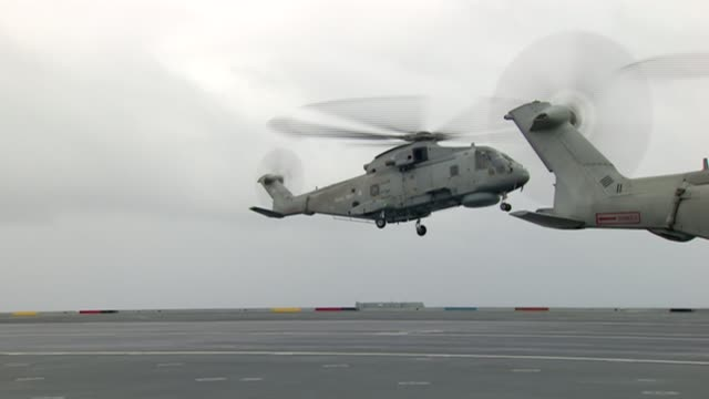 michael fallon visits hms queen elizabeth aircraft carrier scotland inverness hms queen elizabeth ext helicopter landing on aircraft carrier /... - aircraft carrier stock videos & royalty-free footage